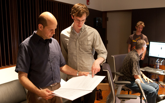 Discussing the score for Oberlin Illuminate with conductor Raphael Jimenez during a break